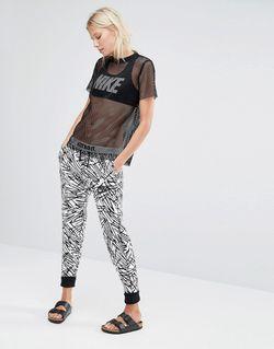 Трикотажные Штаны Суперзауженного Кроя С Пальмовым Принтом Nike                                                                                                              черный цвет