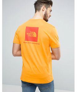 The North Face   Оранжевая Футболка С Логотипом В Красном Квадрате Сзади