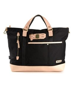Master Piece   Leather Trimmed Tote From Featuring Top Handles A Front Zip Pocket A Tone Logo Plaque A Top Zip Fastening An Internal Logo Patch And A Front Pouch Pocket