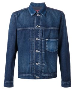 FDMTL | Cotton Stitched Pleat Denim Jacket From Featuring A Classic Collar A Chest Pocket A Front Button Fastening Long Sleeves Button Cuffs And Adjustable Button Tabs At The Hem