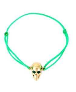 Leivankash | Neon Cotton And 22kt Plated Emerald Eyes Skull Bracelet From