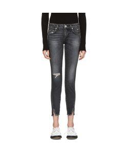 AMO | Distressed Twist Jeans