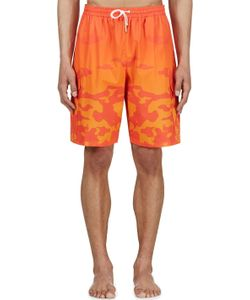 KATIE EARY | Orange Sunset Camo Swim Shorts