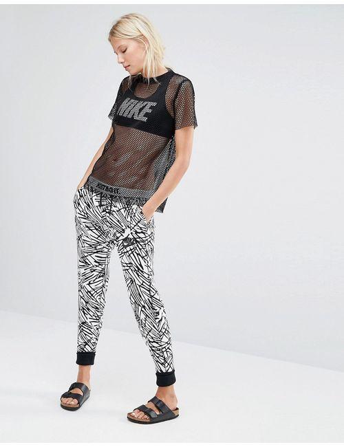 Nike | Чёрные Трикотажные Штаны Суперзауженного Кроя С Пальмовым Принтом